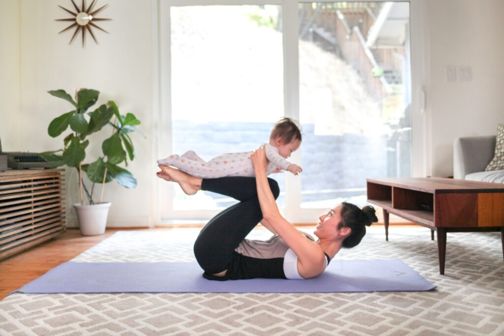 A Mother is Doing Yoga Workout with her Baby
